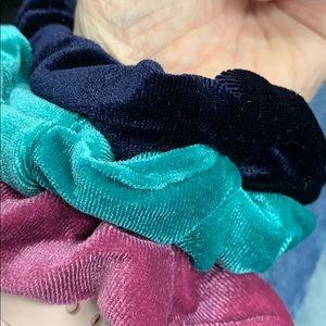 Three velvet scrunchies